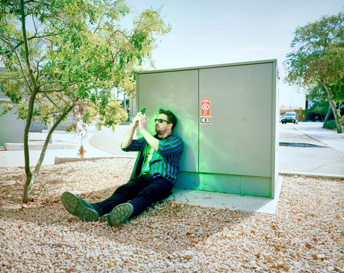 Scottsdale, Arizona, AZ, desert, bathroom, color, film, 6x7, kodak, roadside, brick, purple, green, man, dude, glasses, sun, sunglasses, plaid, street, colorful, power box, america, americana, USA