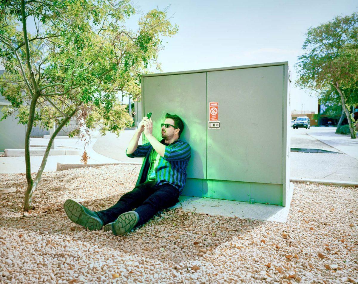 Scottsdale, Arizona, AZ, desert, bathroom, color, film, 6x7, kodak, roadside, brick, purple, green, man, dude, glasses, sun, sunglasses, plaid, street, colorful, power box, america, americana, USA